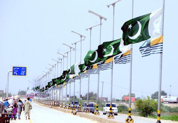 HYDERABAD: August 03 – A view of national flags installed at Qasimabad Road in connection with upcoming Defense Day of Pakistan. APP photo by Akram Ali