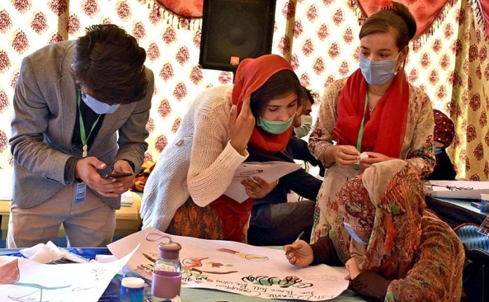 "GILGIT: September 29 - Participants participating in painting competition titled ""Let's Eliminate Corruption for a Prosperous Pakistan"" arranged by NAB. APP Photo by Ashraf Hussain"
