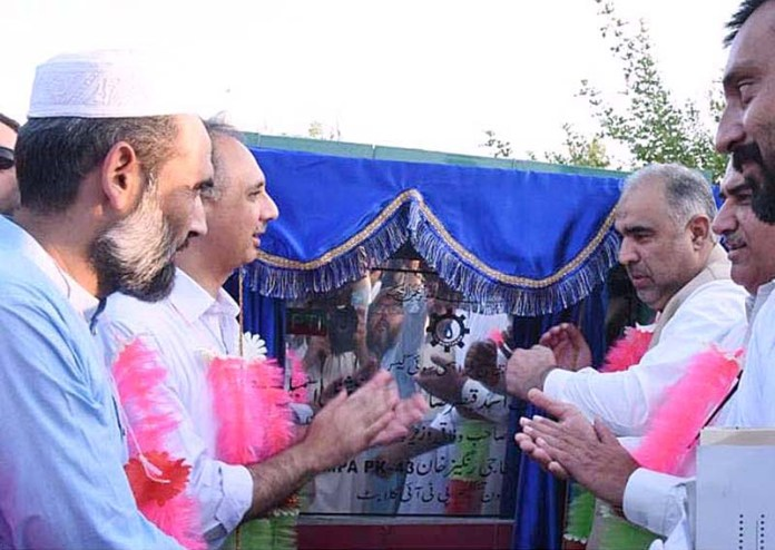 SWABI: September 20 - Speaker National Assembly Asad Qaiser along with Federal Minister for Energy Omar Ayub Khan inaugurates Gas Scheme at Kalabat, District Swabi. APP