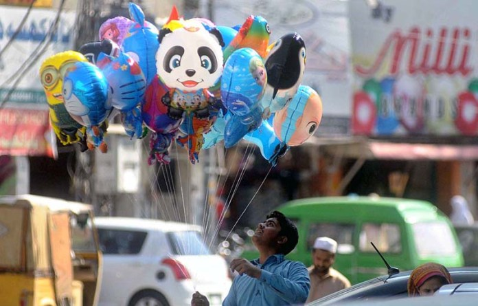 RAWALPINDI: September 08 – A vendor displaying different cartoon characters balloons to attract the customers at Commercial Market. APP photo by Irfan Mahmood