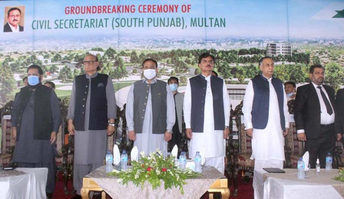 MULTAN: September 17 - Punjab Chief Minister Sardar Usman Buzdar along with others standing in the respect of National Anthem during ground breaking ceremony of South Punjab Secretariat at Circuit House. APP photo by Tanveer Bukhari