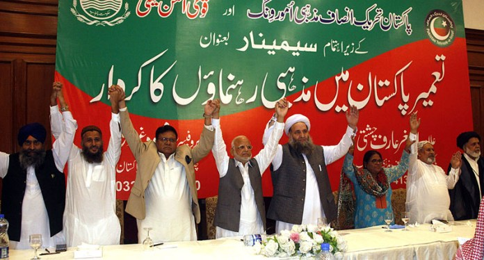 LAHORE: September 19 – Federal Minister for Religious Affairs and Interfaith Harmony Pir Noor-ul-Haq along with other religious leader of different faiths raising hands during a seminar on titled Roll of Religious Scholars in Building Pakistan. APP Photo by Rana Imran