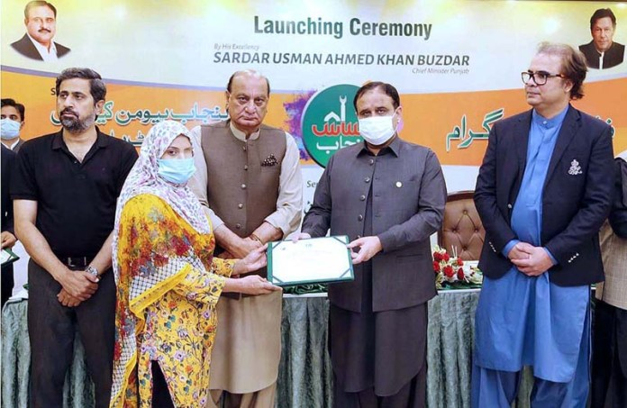 LAHORE: September 12 - Punjab chief Minister Sardar Usman Buzdar distributing registration certificates among the acid victims under the Punjab Ahsas Programme
