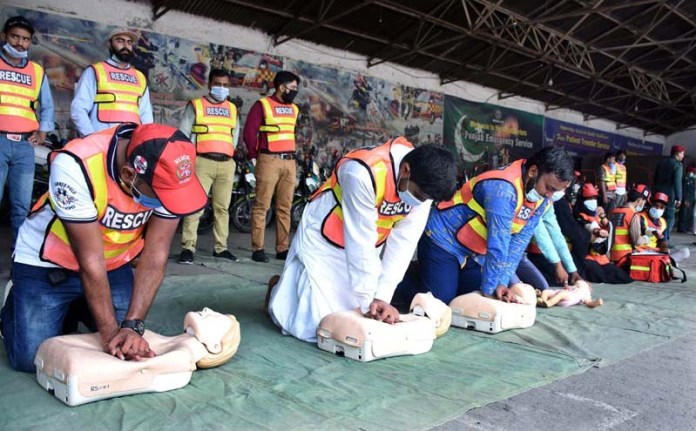 LAHORE: September 12 - Staffers demonstrating their skills during a programme arranged by Rescue-1122 to mark the World First Aid Day. APP Photo by Rana Imran