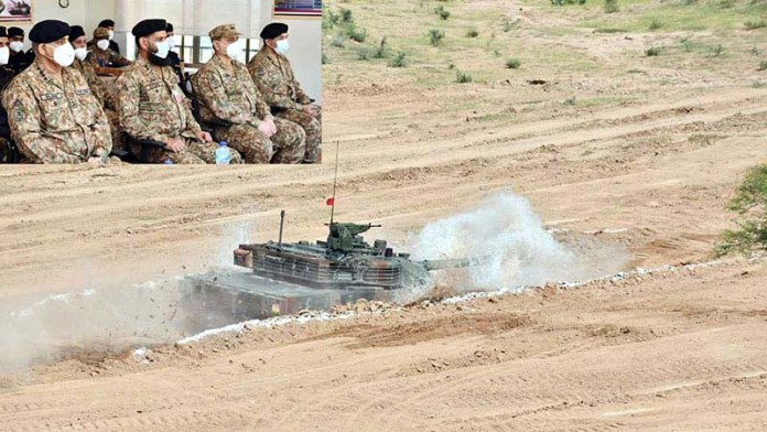 TILA: September 22 - Chief of Army Staff (COAS) General Qamar Javed Bajwa witnessing demonstration of state of the art, Chinese origin third generation Main Battle Tank VT-4 after induction during his visit to field firing ranges near Jhelum. APP