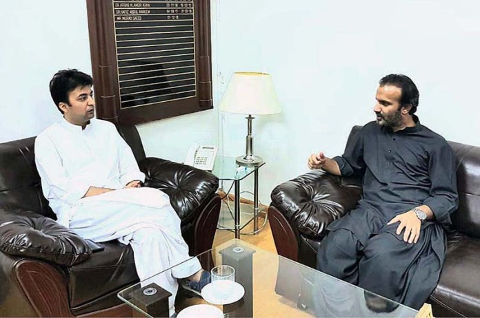ISLAMABAD: September 03 - Managing Director Pakistan Bait ul Mal Aon Abbas Buppi and Federal Minister for Communication Murad Saeed during a meeting. APP