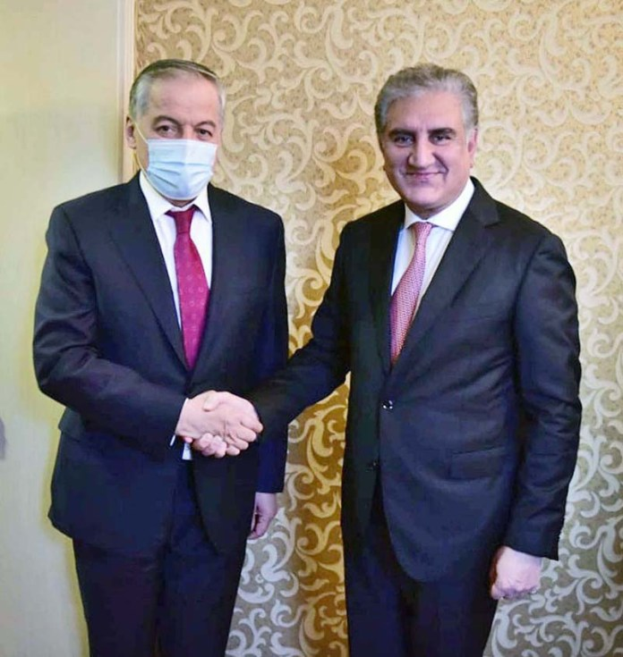 MOSCOW: September 09 - Foreign Minister Makhdoom Shah Mahmood shaking hand with his Tajik counterpart Sirojiddin Muhriddin before meeting. APP