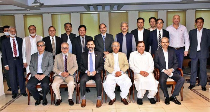 ISLAMABAD: September 03 - Advisor to the PM on Finance and Revenue Dr Abdul Hafeez Shaikh and Governor SBP Raza Baqir in a group photo along with senior officers of Finance Division on the eve of farewell party in honour of Adl Secretary/Spl. Assistant to Advisor Finance A Akbar Sharifzada hosted by officers of Finance Division at Finance Division. APP