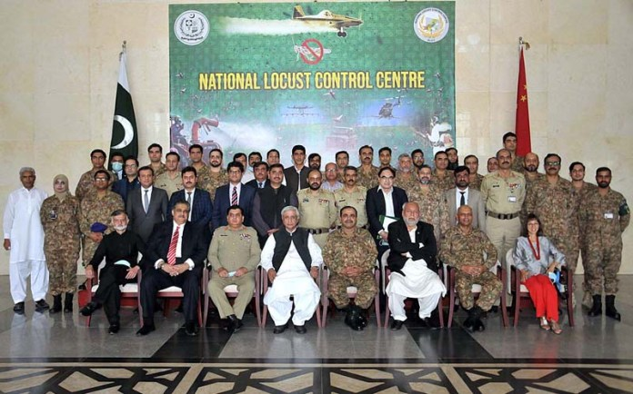 ISLAMABAD: October 09 - Federal Minister NFSR, Syed Fakhar Imam in a group photo with the participants during the closing ceremony of meeting of National Locust Control Centre (NLCC). APP photo by Saeed-ul-Mulk