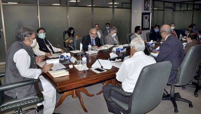 ISLAMABAD: October 14 - Federal Minister for Maritime Affairs, Ali Zaidi chairing the meeting of Inter-Ministerial Committee (IMC) co-chaired by the Minister for Privatisation Mohammedmian Soomro to review results of the auction of government owned properties. APP photo by Saleem Rana