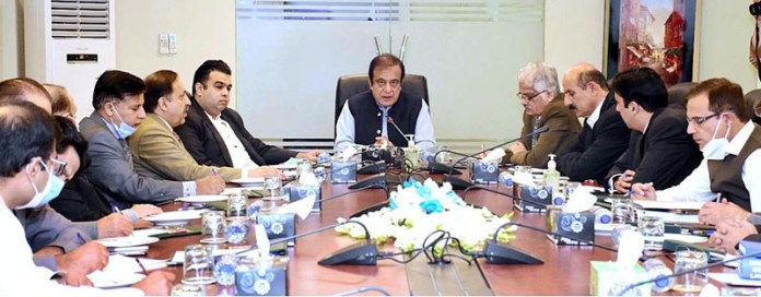 ISLAMABAD: October 14 - Senator Shibli Faraz, Federal Minister for Information and Broadcasting being briefed about the working and functioning of PEMRA. APP