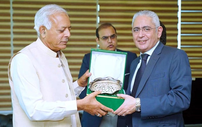 ISLAMABAD: October 07 - Federal Minister for Aviation, Ghulam Sarwar Khan presenting a shield to Egyptian Ambassador Tarek Mohamed Hussein Dahroug. APP