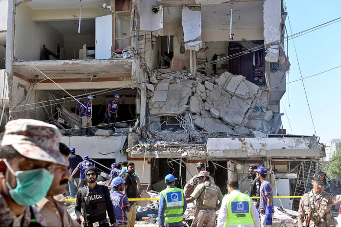 KARACHI: October 21 - Security and rescue personnel look for survivors amid the rubble of a damaged building following the explosion at Maskan Chowrangi in Gulshan-e-Iqbal. APP Photo by Saeed Qureshi