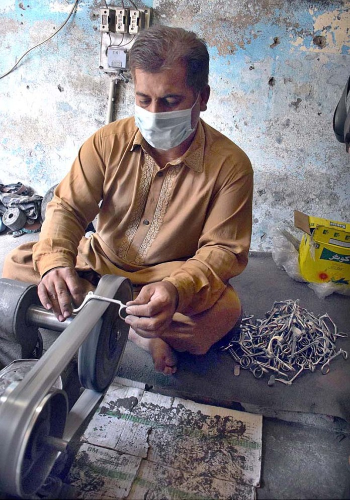 SIALKOT: October 23 - A preparing surgical instruments in a factory. APP Photo by Munir Butt