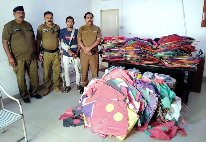 BAHAWALPUR: October 02 - Bahawalpur Police arrested accused Omar Waqas and recovered 200 kites from his possession. APP photo by Hassan Bukhari