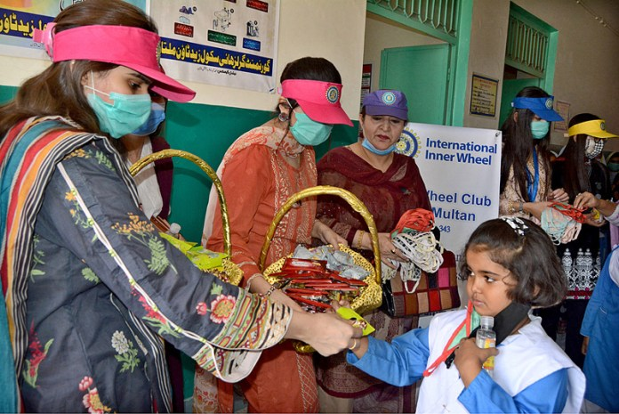 MULTAN: October 21 - Members Inner Wheel Club distributing masks among the students at Government Girls High School Z Town. APP photo by Safdar Abbas