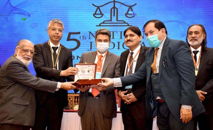 KARACHI: October 17 - Barrister Farogh Naseem, Federal Minister for law and justice is being presented memento during the 5th National Judicial Conference 2020. APP
