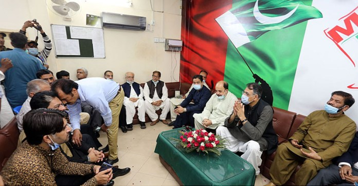 HYDERABAD: October 24 – Federal Minister for Planning, Development and Special Initiatives Asad Umar in a meeting to MQM MPs at MQM Pakistan district office. APP photo by Akram Ali