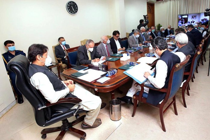 ISLAMABAD: October 06 - Prime Minister Imran Khan chairing a meeting to review wheat and sugar stock, availability, import situation and prices of essential commodities. APP