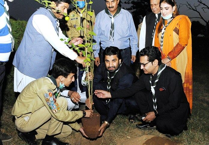 ISLAMABAD: October 06 - Deputy Speaker National Assembly Qasim Khan Suri planting a sapling at an event organized by Pakistan Boys Scout Association. APP