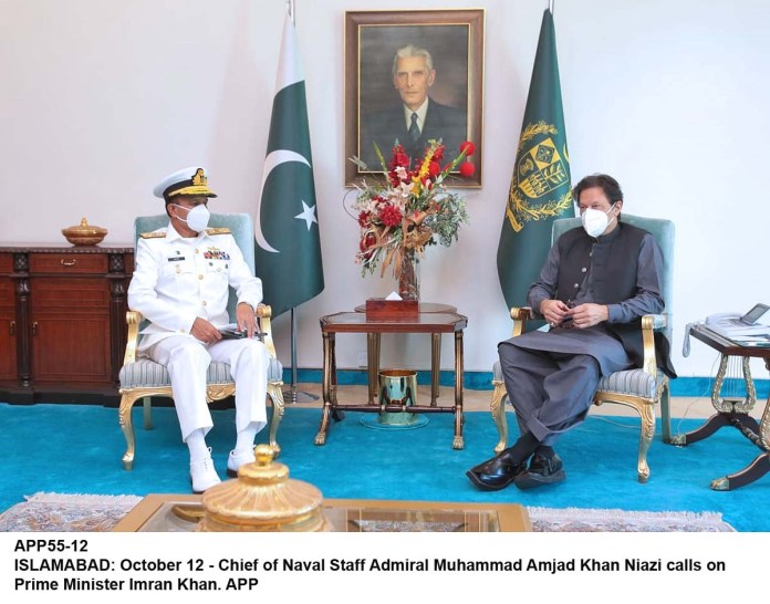 ISLAMABAD: October 12 - Chief of Naval Staff Admiral Muhammad Amjad Khan Niazi calls on Prime Minister Imran Khan. APP