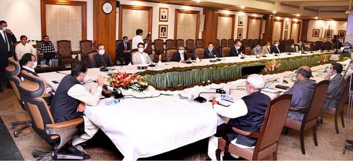 LAHORE: October 20 - Prime Minister Imran Khan chairs a high level meeting regarding availability of essential items. APP