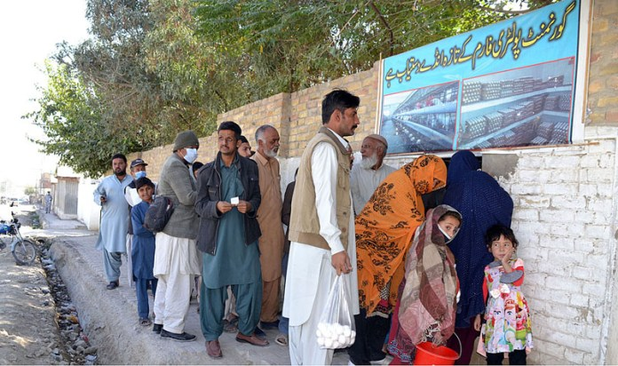QUETTA: October 15 - People purchasing eggs from Livestock Department at Brewery Road. APP photo by Mohsin Naseer