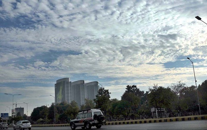 A view of scattered clouds hovering over the skies of the city