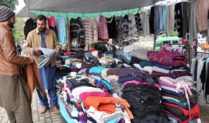 A vendors displaying old woolies to attract the customers