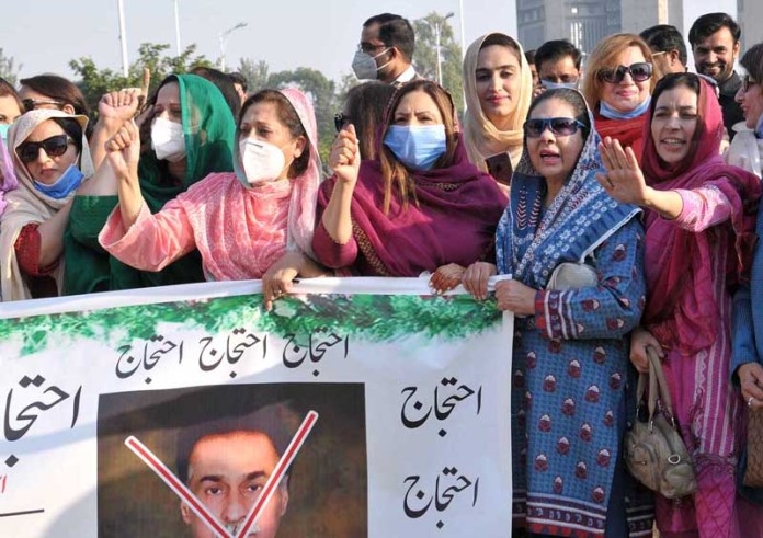 ISLAMABAD: November 02 - PTI workers holding a protest in collaboration with Islamabad Region against the anti-national statement of PML-N MNA Ayaz Sadiq at National Press Club. APP photo by Saeed-ul-Mulk