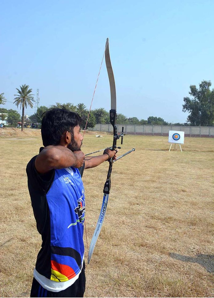 FAISALABAD: November 06 - An archer aiming the target during Inter-District Archery Championship at Kaleem Shaheed Park organized by Sports Department. APP photo by Tasawar Abbas