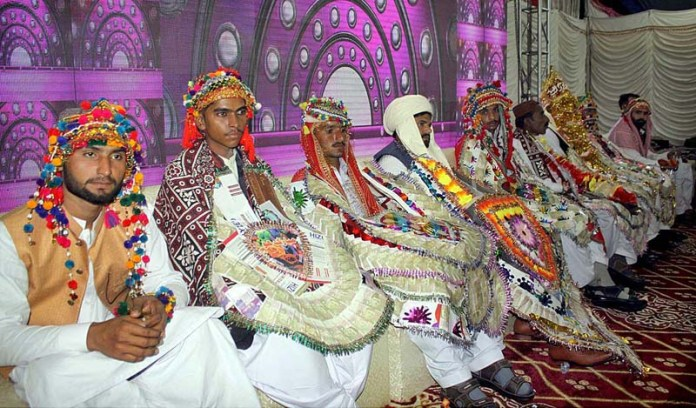 HYDERABAD: November 14 – A large number of grooms sitting on stage during collective marriage organized by Jailani Welfare Organization at Bagh-e-Mustafa Ground. APP photo by Akram Ali