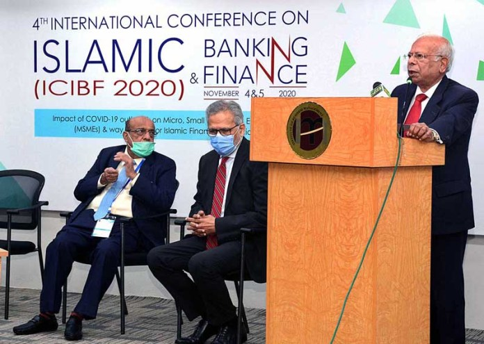 KARACHI: November 04 – Dr. Ishrat Hussain, Advisor to Prime Minister for the Institutional Reform and Austerity addressing during 4th International Conference on Islamic Banking and Finance (ICIBF2020) at the Institute of Business Management (IoBM). APP Photo by M Saeed Qureshi