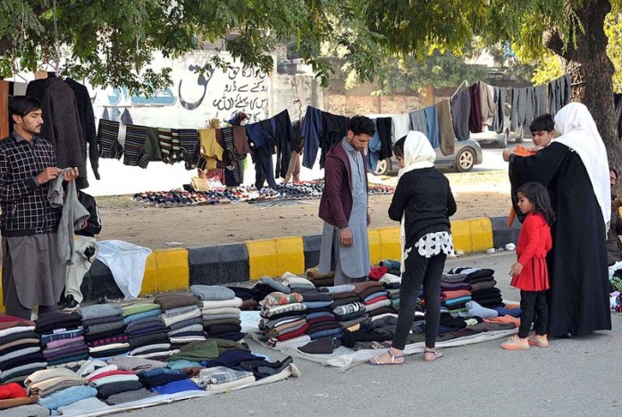 Vendors displaying old woolies to attract the customers at their roadside setup