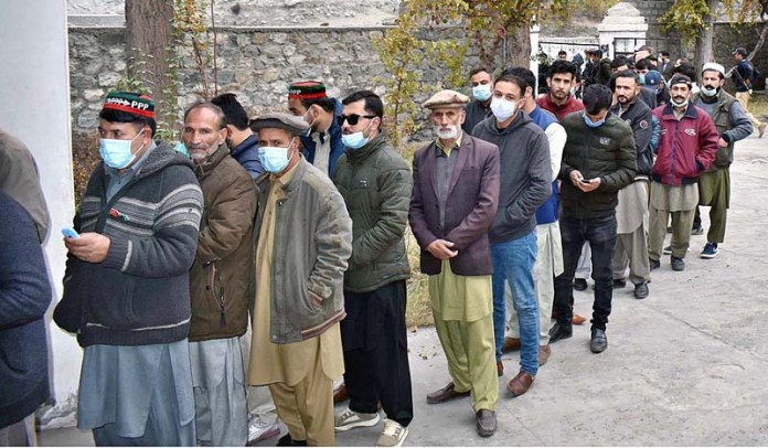 People standing in queue at polling station to cast their vote during Gilgit-Baltistan Election 2020