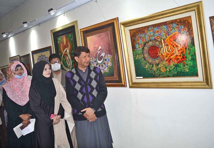 VC University of Sargodha Dr. Ishtiaq Ahmad viewing art work during calligraphy exhibition in connection with celebration of Shan-e-Rehmatul-Lil-Alameen Week at Sargodha University