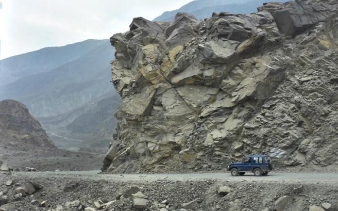 JUGLOT: November 08 – A vehicle passing on Karakorum Highway near Juglot. APP photo by Irshad Sheikh