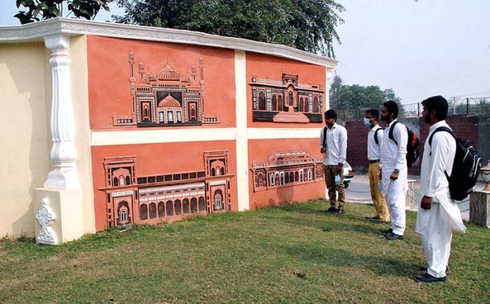 Students viewing a model wall made outside historical Darbar Palace