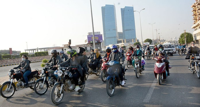 Women riders participating in a motorcycle rally for Women Empower and Awareness in the society organized by Hero motorcycle and Pink Pakistan at Clifton