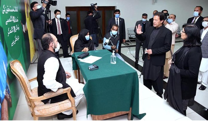 SAPM Dr Sania Nishtar briefing Prime Minister Imran Khan during his visit to Ehsaas Kafaalat Payment site