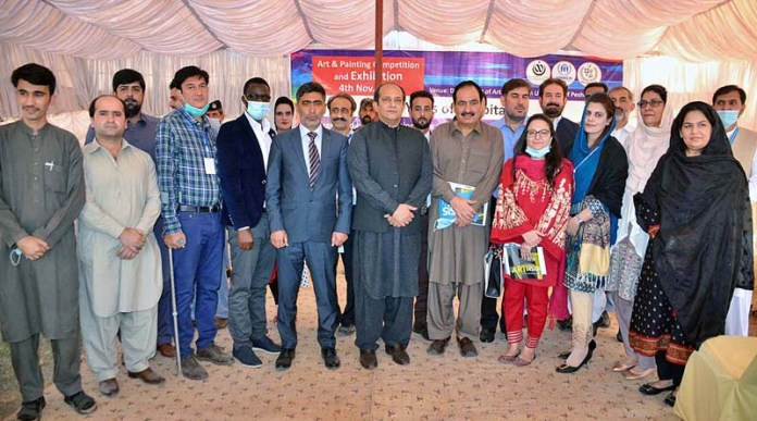 PESHAWAR: November 04 - Commissioner of CAR Muhammad Abbas, Project Manager UNHCR Gabriel in a group photo during Art & Painting Exhibition and Competition organized by Commissionerate for Afghan Refugees KP at Art and Design University. APP Photo by Shaheryar Anjum