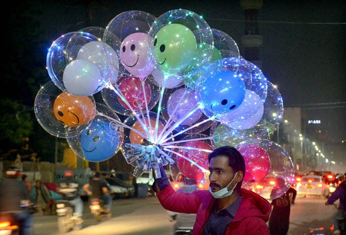 A vendor displaying led light balloons to attract customers