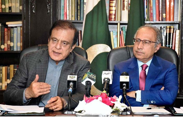 Adviser to the Prime Minister on Finance and Revenue, Dr. Abdul Hafeez Shaikh and Federal Minister for Information and Broadcasting, Senator Shibli Faraz addressing a joint press briefing at Finance Division