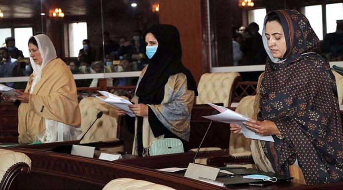 Newly elected members of Gilgit-Baltistan Assembly giving oath during a ceremony administering by Speaker Gilgit-Baltistan Assembly Haji Fida Muhammad Nashad