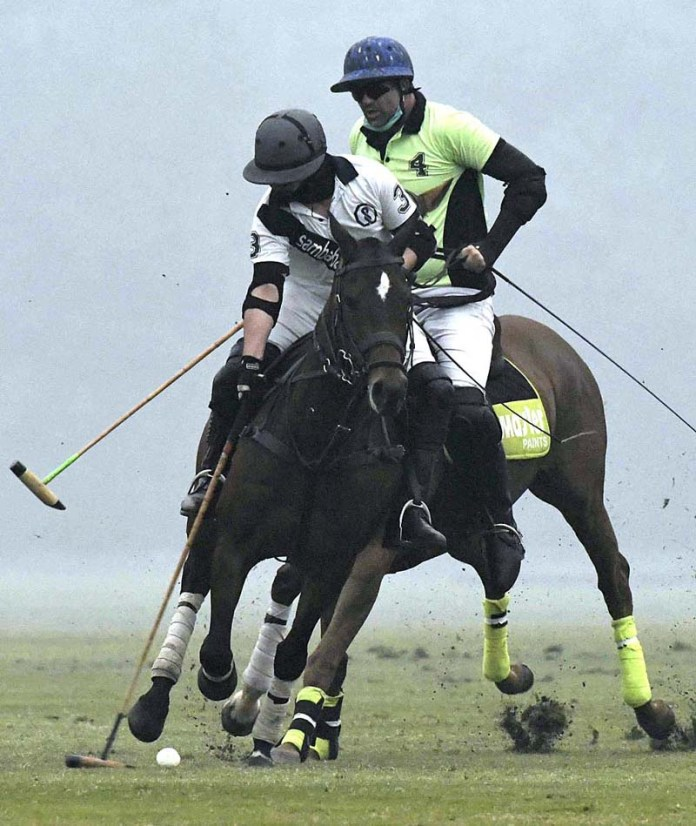 Players struggling to get hold on the ball in a match between Samba Bank and Pricemeterpk played at Aibak Ground Polo Club as part of Happy Cow Polo for Peace-II for Pakistan Polo Cup 2020