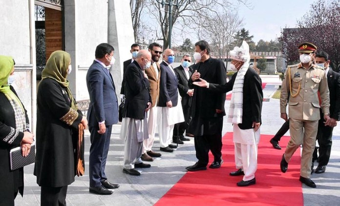 President of Afghanistan Ashraf Ghani introducing members of his government's delegation to Prime Minister Imran Khan at the Presidential Palace