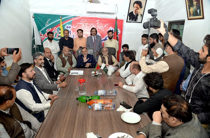 LAHORE: November 06 - Federal Minister for Anti-Narcotics Azam Khan Swati addressing to the workers of PTI at the PTI office. APP photo by Amir khan