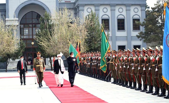 Prime Minister Imran Khan reviewing guard of honour presented to him during the official reception at the Presidential Palace