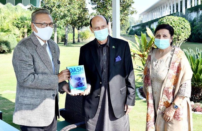 "Olympian Islahuddiqui along with his spouse presenting his ""Dash Through My Life"" to President Dr Arif Alvi, at Aiwan-e-Sadr"