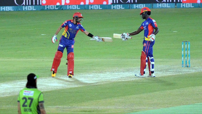 Karachi Kings Babar Azam celebrating with Chadwick Walton his fifty runs during final match of Pakistan Super League (PSL) Twenty20 played at the National Stadium